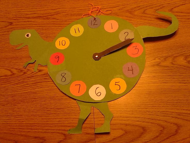 Paper toothless dinosaur clock inspired by a laser cut wooden dinosaur clock at https://www.etsy.com.  Preschool & school age children glue pre-cut parts of an animal, toy or food together.  Next, hand write numbers or add adhesive number stickers to make a clock craft.  The circle shapes & animal's teeth are optional.  Toddlers may need an adult's help to glue pre-cut parts of an animal, toy or food & shapes to make an animal, toy or food color chart.