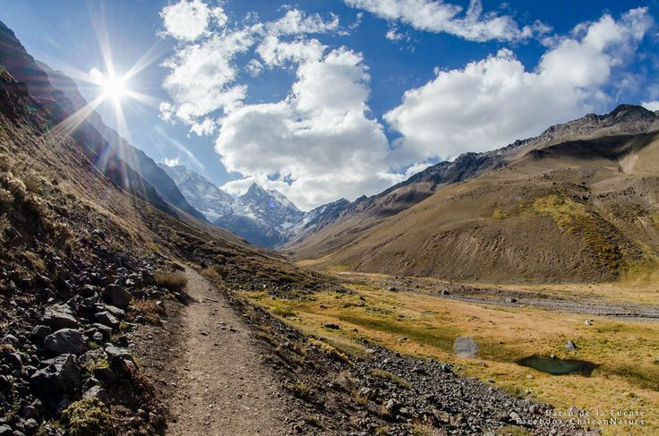 https://flic.kr/p/tthj2c | Andes Landscape | This is a typical scenary at Chilean Central Andes. Small valleys that turn from yellow (summer - autumn) to white (winter), to green (Spring).  Clouds are always part of the landscape, so you better hope they don't get angry... or you better run!  May 2015. Rokinon 8mm Fish Eye, f8