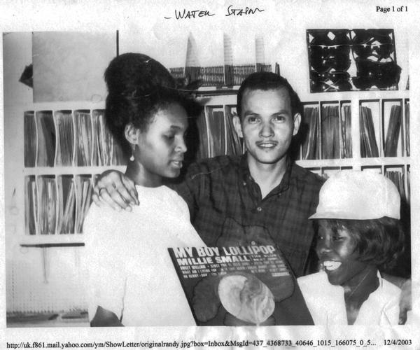 Millie Small poses with her record and Vincent Chin, founder of what is now the largest reggae distributor in the world, VP Records.    Randy's Records, 1964.