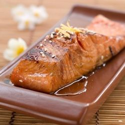 Sweet Sesame Salmon    Ingredients:  4 Salmon fillets  6 tablespoons of Raw Organic Honey  4 tablespoons of Sesame seeds  1 cup baby tomatoes  1 head of asparagus  1 chopped cucumber  Extra Virgin Olive Oil for cooking  1 lemon