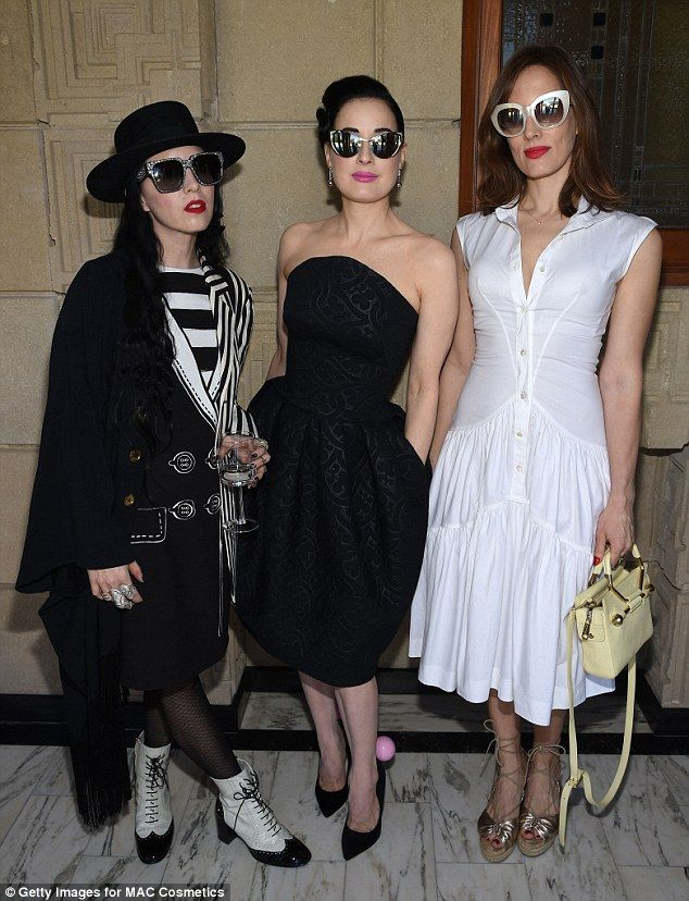 Light and dark: Costume designer Bianca Akerlund went for a Gothic vibe as did Dita while Liz opted for a flirty white summerdress and retro shades