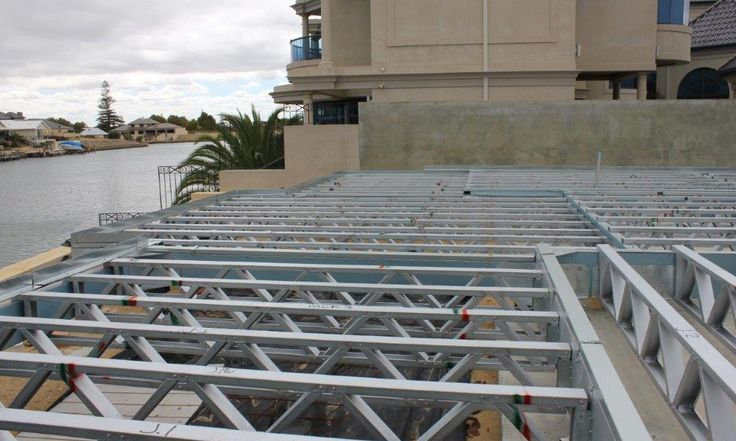 Truss floor system for fast build light weight 2 storey homes, before building the upper storey on the canals in Mandurah