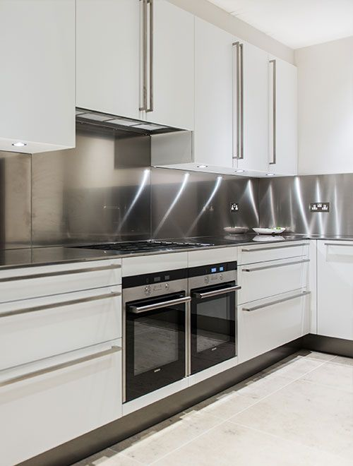 Kitchen with stainless steel splashback, Bedford Gardens