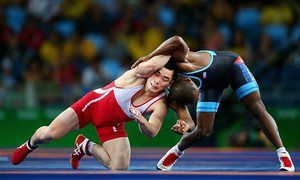 Kyong Il-yang of North Korea competes against Yowlys Bonne Rodriguez of Cuba during their men's 57kg repechage wrestling match