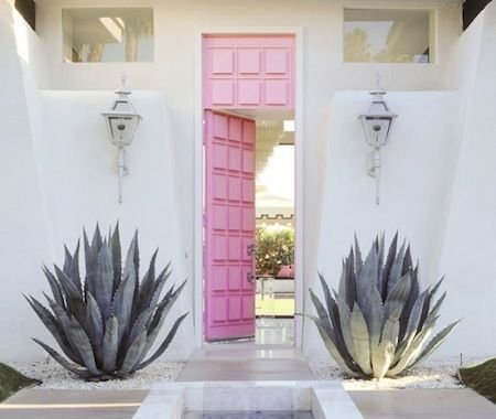Pink doors framed by Agave americana
