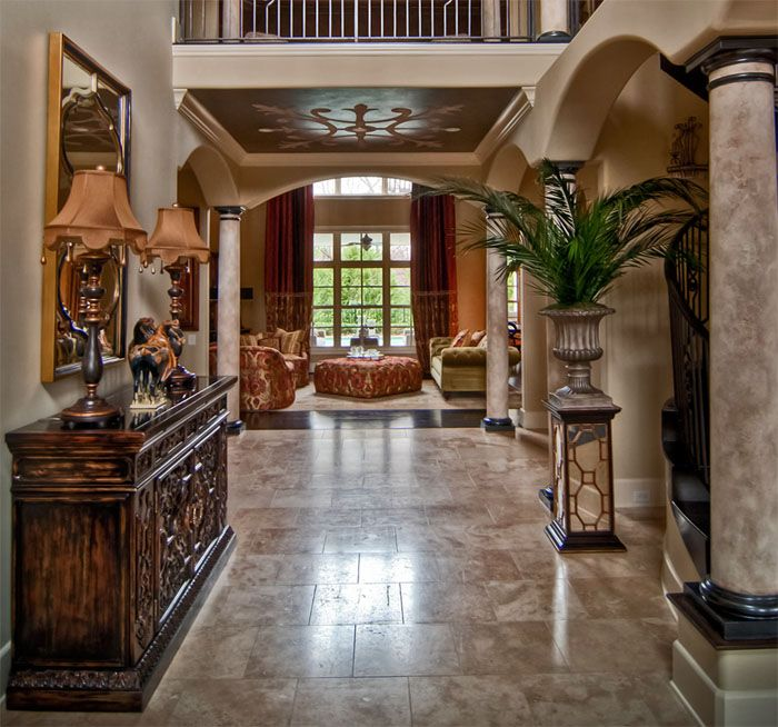 """a little less """"formal"""" on the decor but love the design of the home and that hutch on the wall!"""