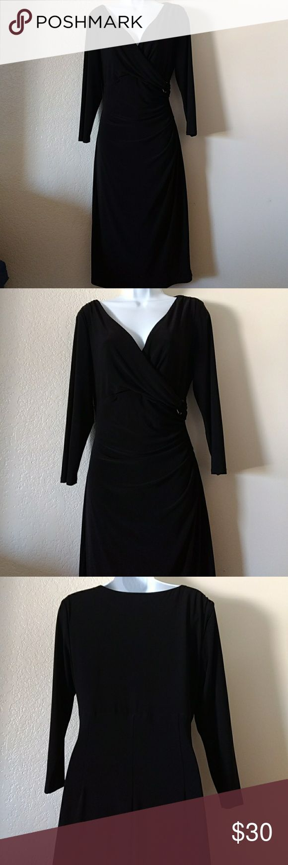 "Ralph Lauren Cross Front Dress Size 12 Black Ralph Lauren cross front sheath dress size 12 V neckline 3/4 sleeve black 95% polyester 5% elastane approx measurements armpit to armpit 21 1/2""  waist 30"" length 43"" in excellent pre-owned condition Ralph Lauren Dresses"