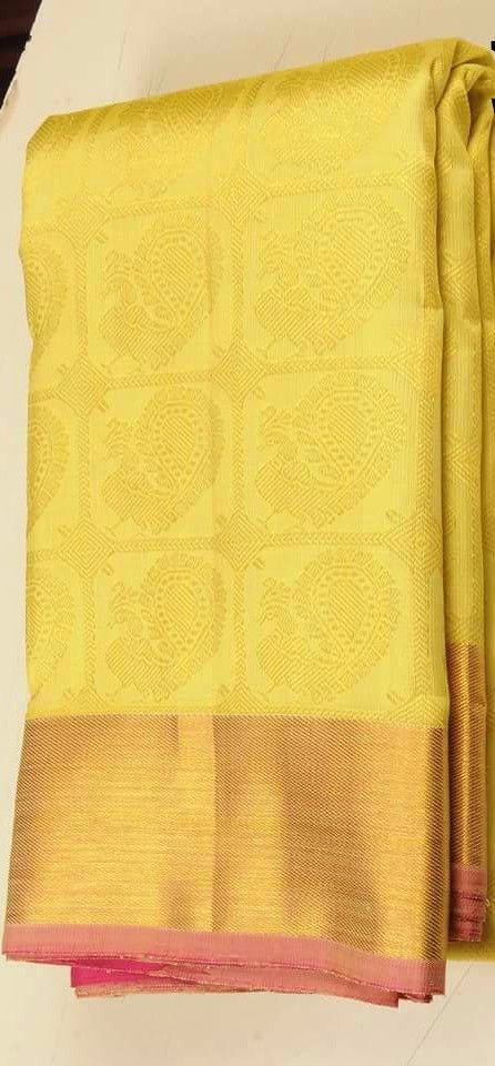 Yellow traditional kanjeevaram saree
