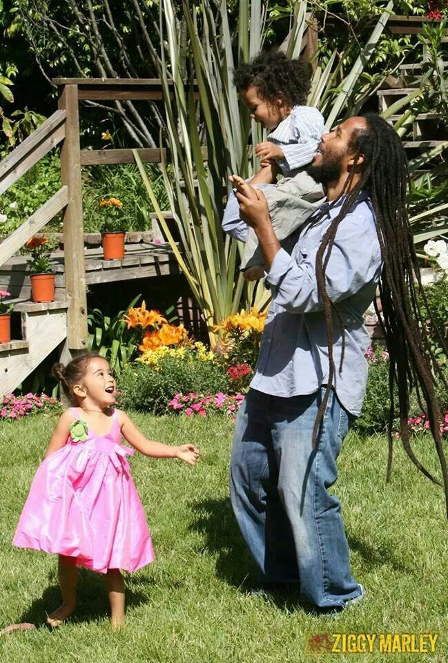 Ziggy Marley playing with his kids