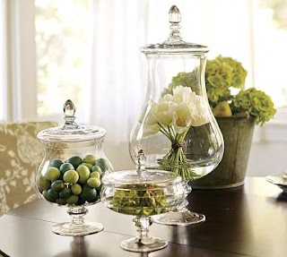 We use glass jars in our staged kitchens ALL the time...but never as centerpieces--Love this!
