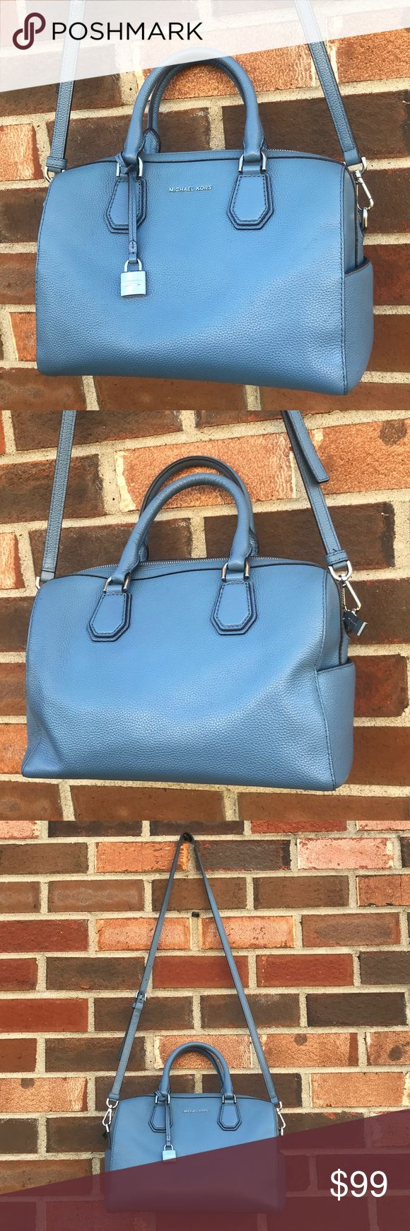 "PRICED TO SELL! Michael Kors Mercer duffle Purse Beautiful MK Purse! Denim color, I believe. Adjustable shoulder strap and silver hardware. Two button snap side pockets. Priced to sell! Roomy and practical :) measures approx 11 1/2""x9""x7"". Shows some signs of use, see last photo for details! Small scuffs, metal feet show scuffs, and color rub in certain spots. Not noticeable when using, only when looking for them. Interior shows minor use and overall very clean! Michael Kors Bags Satchels"