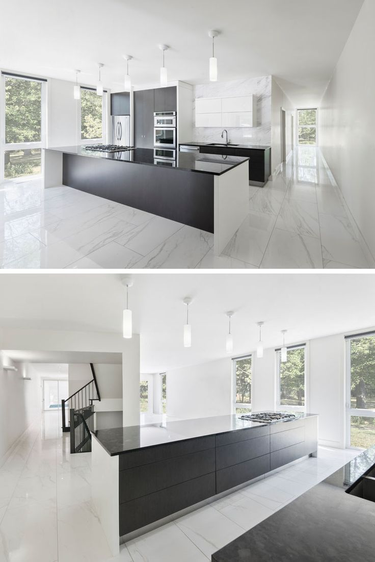 The dark cabinetry and kitchen island contrast with the white walls and marbled floor ...