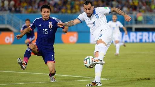 Fulham's Konstantinos Mitroglou in action for Greece against Japan