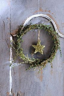 Greenery wreath with moss star (Maybe try a glitter star in the center?)
