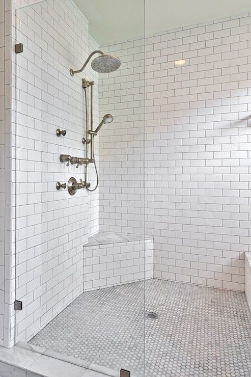 Oversized Shower With Gl Parion Alongside Dual Heads Framed By A Floor To Ceiling Subway Tiled Interior Gray Grout Including