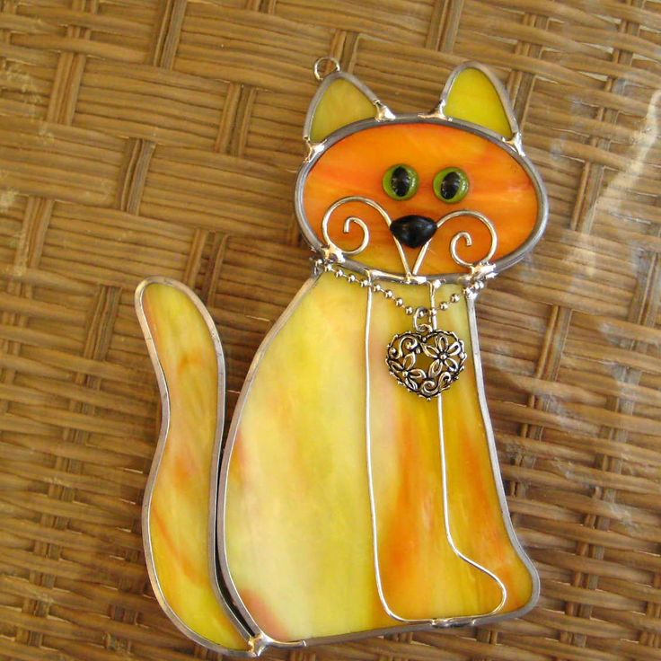 "This little stained glass kitten is litter trained and ready to love. She already has a collar, but needs a name and a permanent home. She measures 5 ½"" x 3 ¼ and comes with a suction cup so you can enjoy her right away. This suncatcher is handcrafted one at a time in my home studio using the lead came method. I have used a lightly textured glass in amber, creamy orange and cream with green eyes. If you would prefer a different eye color, I can change them to amber or blue. Just let me…"