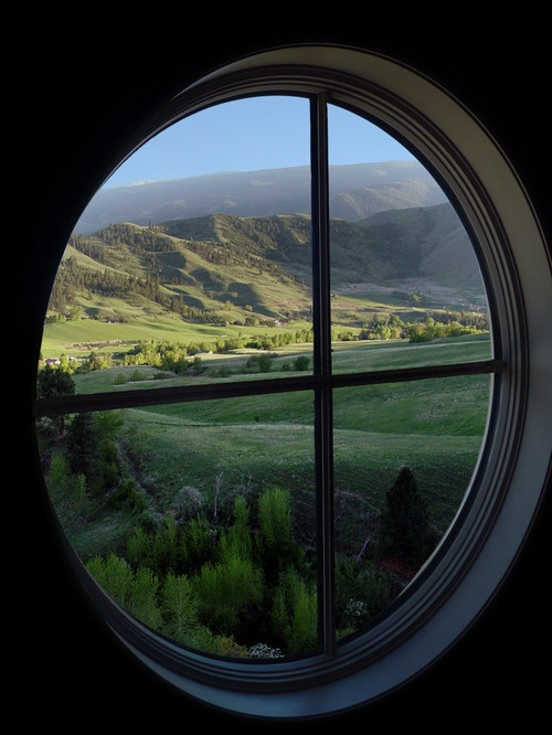 """Lovely """"porthole"""" window, with a truly breathtaking view! Oh, to gaze out of it..."""