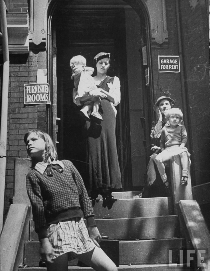 People living in the slums gathered on steps of building. Washington, DC 1937.  By Carl Mydans