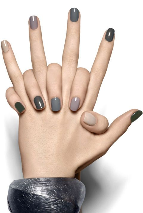 Who says bright colors should have all the fun? Try a muted rainbow to make a multi-colored mani work for fall. We love this pretty array of gray shades created by Essie. They even list every polish you'll need on their site if you want to try it at home. Click through for more on this and other gray nail art ideas for fall.