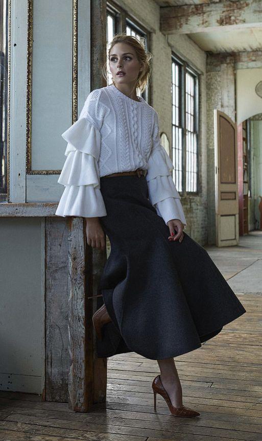 Wearing a Valentino sweater, Michael Kors skirt, and belt.