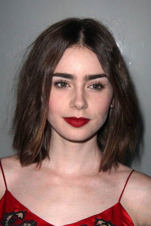 Lily Collins lob for thick hair ~ A-line silhouette w/inner layering. Ideal for all face types except long.