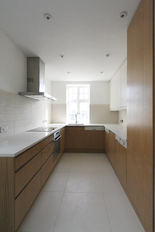 Oak Veneer Handleless Kitchen. Made in bespoke sizes. www.kbstoretrade.co.uk