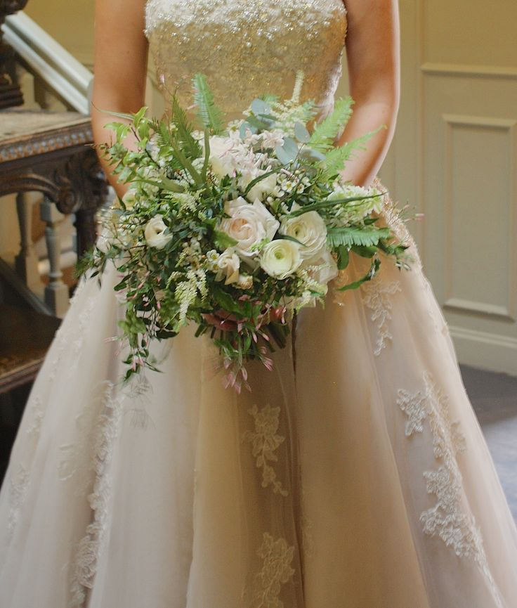 Natural bouquet with lovely foliage trailing jasmine white O'Hara roses, astilbe, anemones & ranunculus. So pretty.
