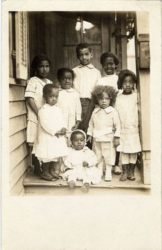 Description: Eight unidentified #African American children posing on the porch.  Vintage African American photography courtesy of #Black History Album, The Way We Were.  Found On Flicker.com in Black History Album