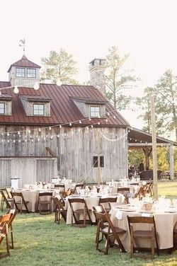 Outdoors, rustic, big twinkly lights. This could also make a wonderfully extravagant birthday dinner!