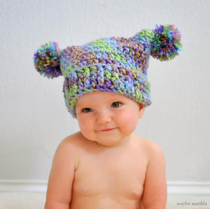 Free tutorial to crochet this cute Double Pom Pom Hat!
