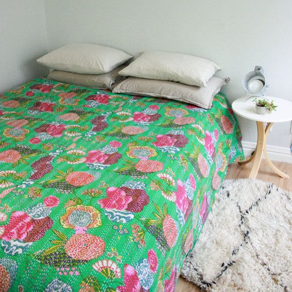 I'm looking to do a bed makeover.  This green 100% cotton blanket is very pretty.  I would balance out the vibrancy of this coverlet with luxurious materials, creams in a dark high-gloss blue room.