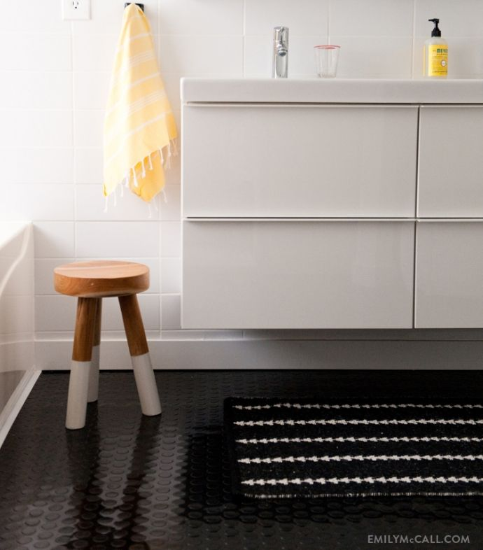 Dip dyed stool, Godmorgon bathroom vanity, and Nate Berkus arrowhead rug