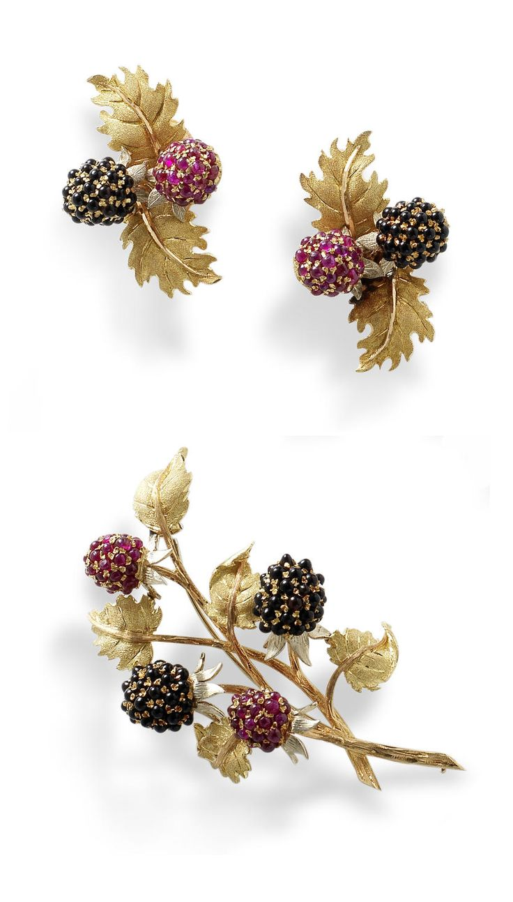 A brooch and earclip suite, by Buccellati, circa 1965  The brooch realistically modelled as a cluster of ripening blackberries, pavé-set with cabochon rubies and onyx, on a textured vari-coloured mount modelled as branches and leaves, each earring of similar design, signed Buccellati Italy, brooch width 7.0cm, earring length 4.0cm, grosgrain pouch by M. Buccellati and case by Buccellati, New York