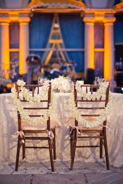 Orchids on bride and groom chairs