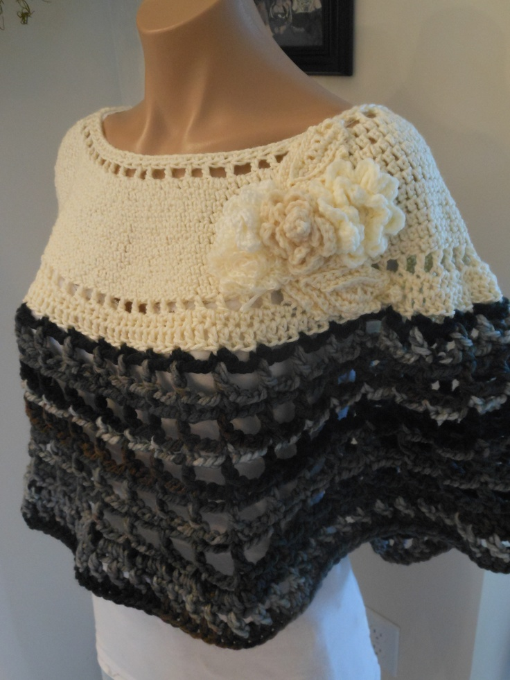Hand crocheted pullover shawl with crocheted flowers accenting the neckline