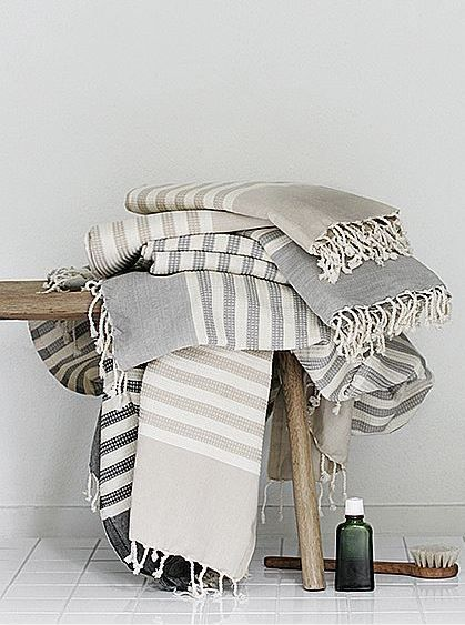 neutral bathroom bathroom accessories + turkish bath towels | rustic wood stool