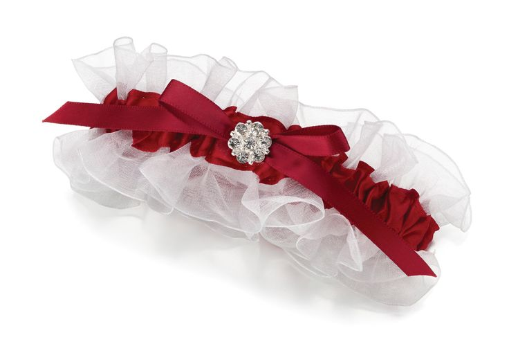Red satin and white sheer make up this elegant leg garter. A red satin bow is decorated with a silver-plated rhinestone ornament. One size fits most.
