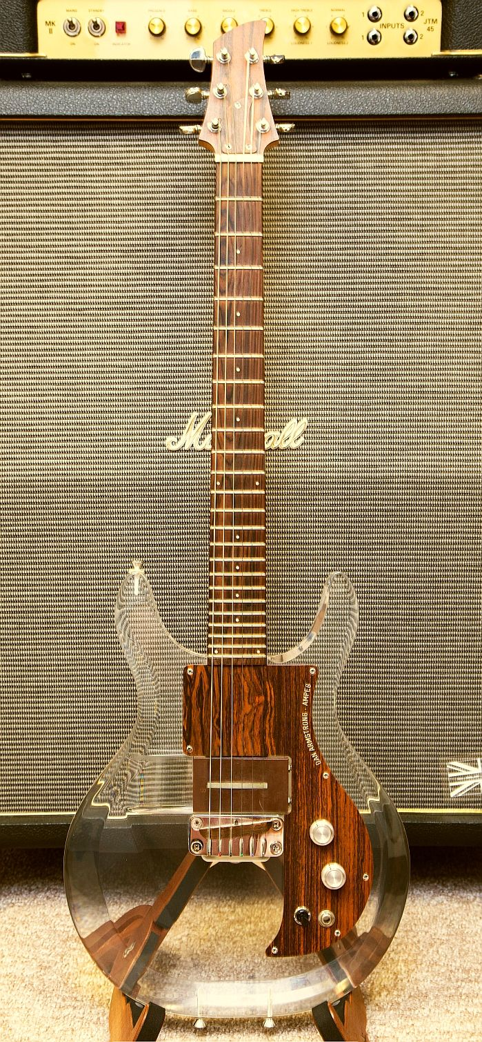 PLAY NAKED: An original 1969 Dan Armstring clear Lucite acrylic guitar by Ampeg. Note the 24 frets, interchangeable pickup, and three strap buttons