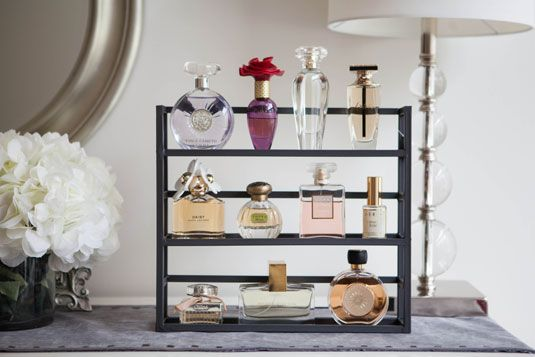 Spice rack for storing your perfume collection? Genius! Click for 23 more unconventional ways to store your beauty essentials. | Cosmopolitan