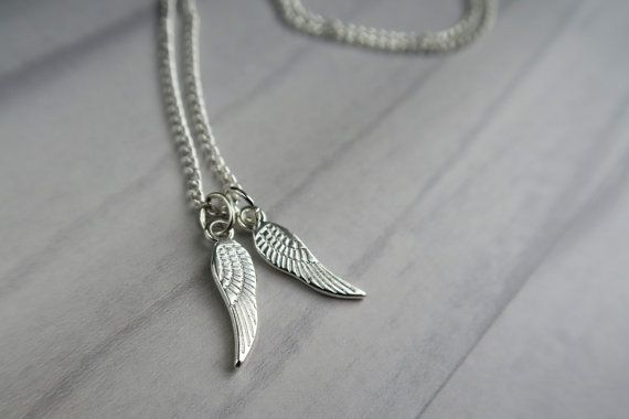 This ladies necklace has a pair of silver angel wings on a fine silver chain. It is a very delicate and feminine necklace.  Also available as a single