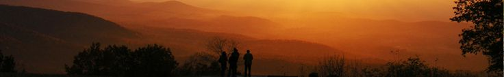 Visitors bask in a golden sunset at Dickey Ridge Visitor Shenandoah National Park