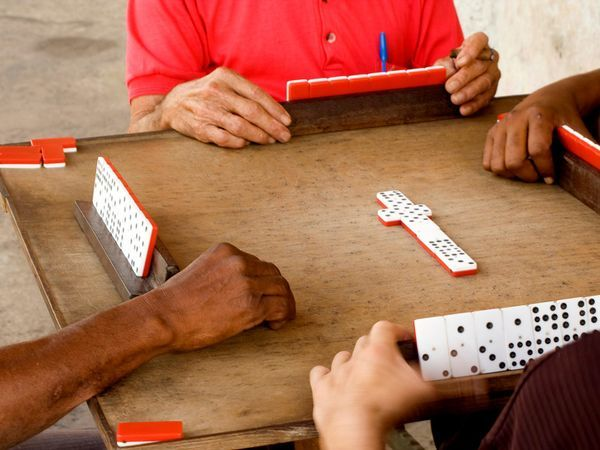Streetside domino games can be seen in many a Cuban neighborhood #cuba
