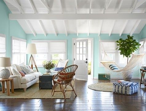 Take the hammock inside for a beachy relaxed hangout area. A breezy beach cottage slash bungalow. Makeover after hurricane damage. It's also Country Living's House of the Year in 2013. Take the tour here: http://www.completely-coastal.com/2013/08/beach-bungalow-makeover-Country-Living.html