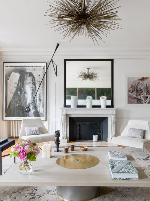 b/w artwork + spiky ceiling fixture + chunky coffee table