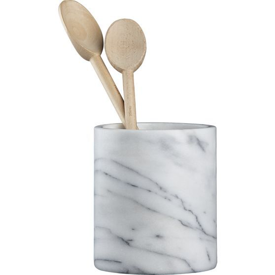 A substantial cylinder of cool white marble with unique grey veining keeps utensils at hand in grand style.