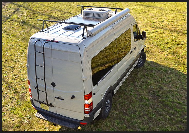 Cannonball By Outside Van Roof Holds AC Unit Solar Panel Skylight And Rack