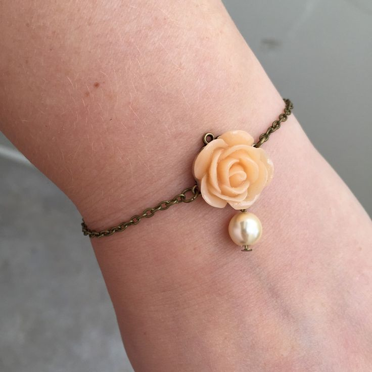 A personal favorite from my Etsy shop https://www.etsy.com/listing/234485661/pretty-bracelet-with-peach-flower-and