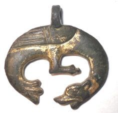 Amulet Pendant, Vikings. Sea dragon biting its own tail. 12th century