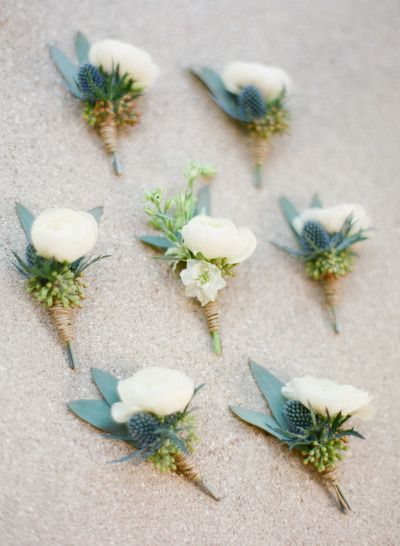 Ranunculus and thistle boutonnieres: http://www.stylemepretty.com/2015/04/28/red-french-blue-al-fresco-estate-wedding/ | Photography: Justin DeMutiis - http://justindemutiisphotography.com/