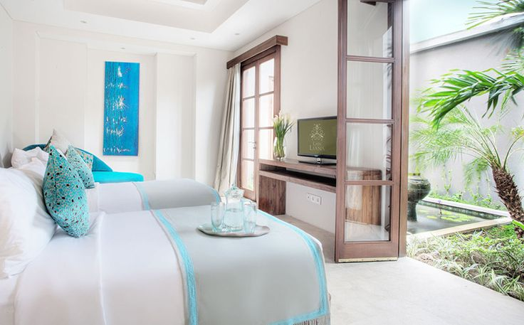 MARINA Bedroom by Canela Bali.  Simple wooden double beds and TV desk.  Get your own on https://www.canelabali.com/canelabalibedroom